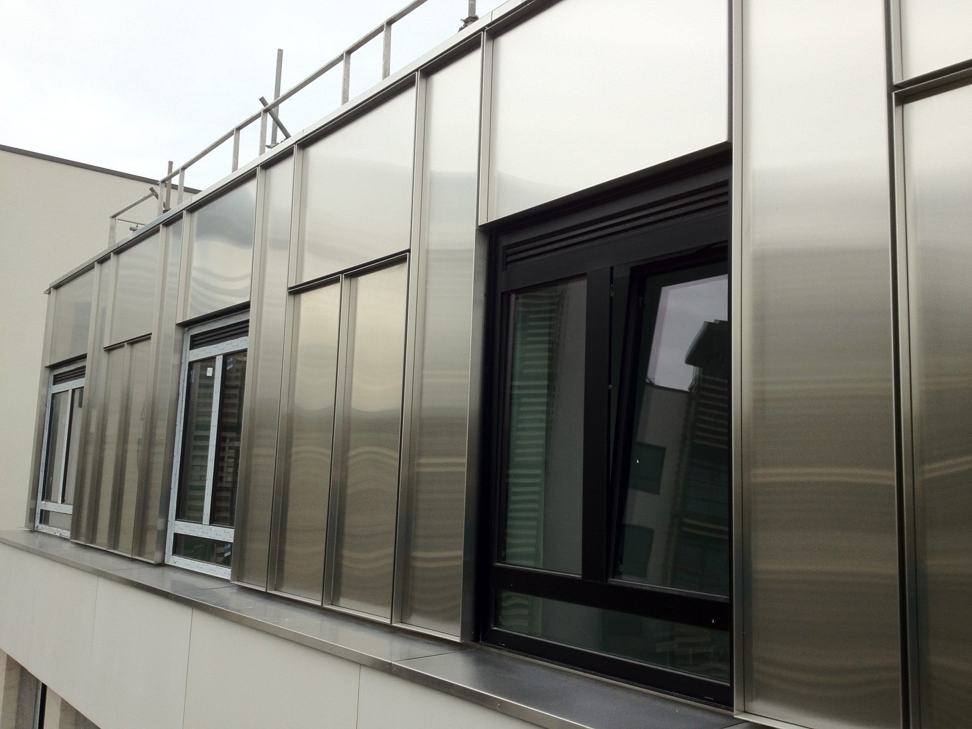 Rigidized stainless steel rainscreen cladding | Athletes Village